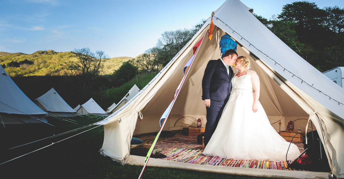 A couple, on their wedding day in a yurt in Snowdonia