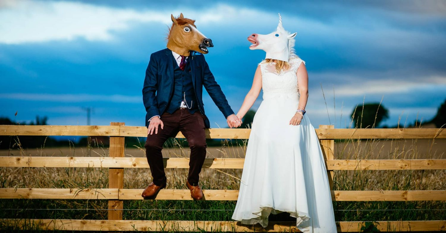 Alternative Festival Wedding Photographers Bride and Groom wearing horses heads