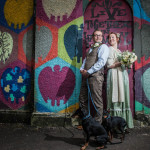Cardiff Wedding Photographers image of a bride and groom by a wall
