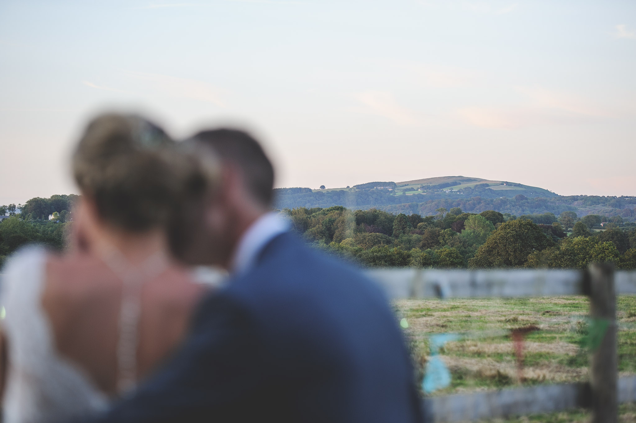 Image of bride and groom looking towards Garth Mountain