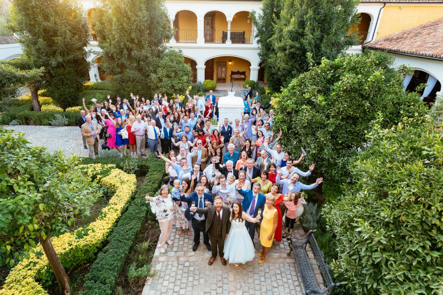 Wedding Guests cheering and waving at Alternative Wedding Photographers in Spain