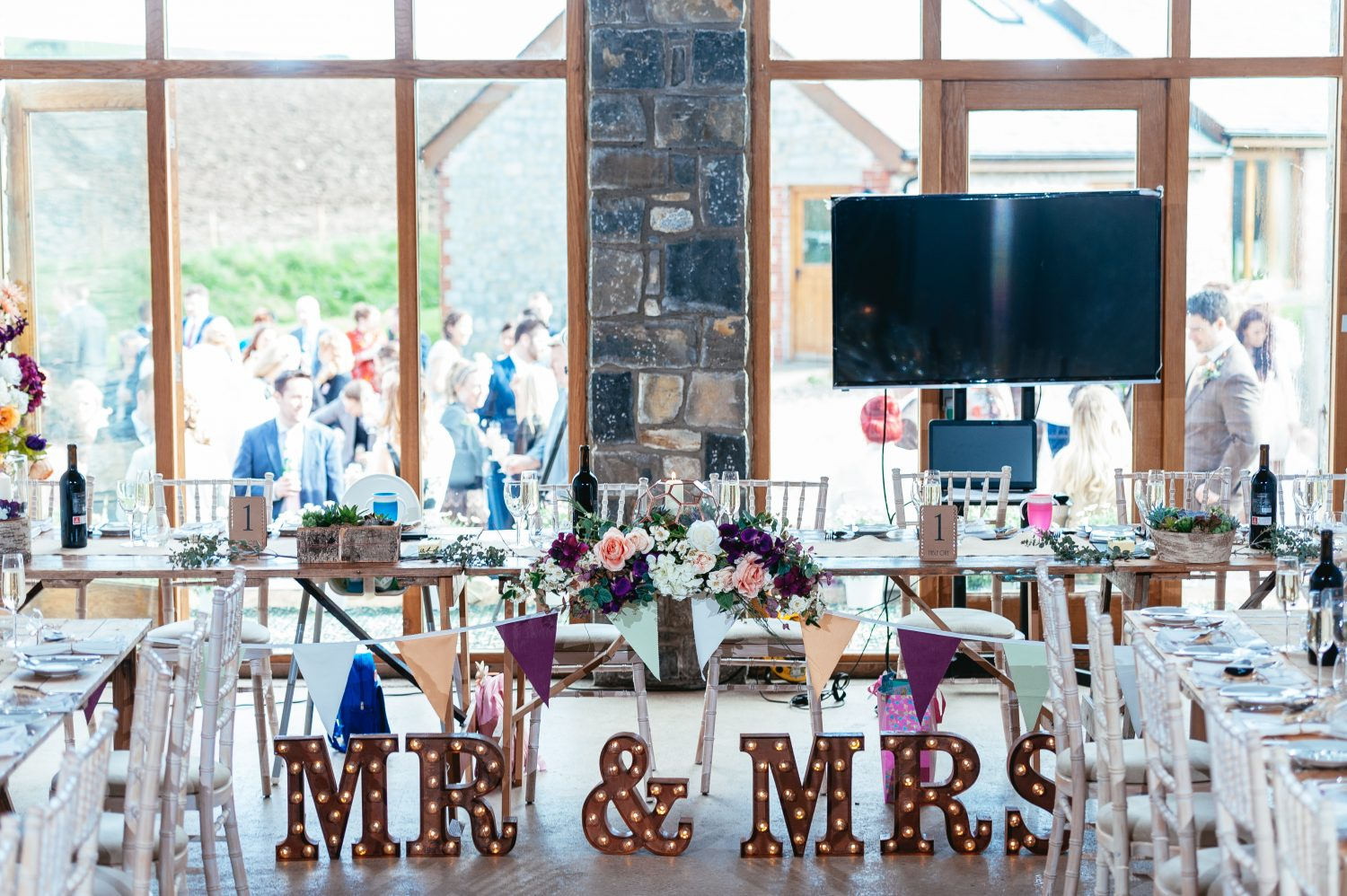 The Top Table Set up in the Farmer's Barn by South Wales Wedding Photographers