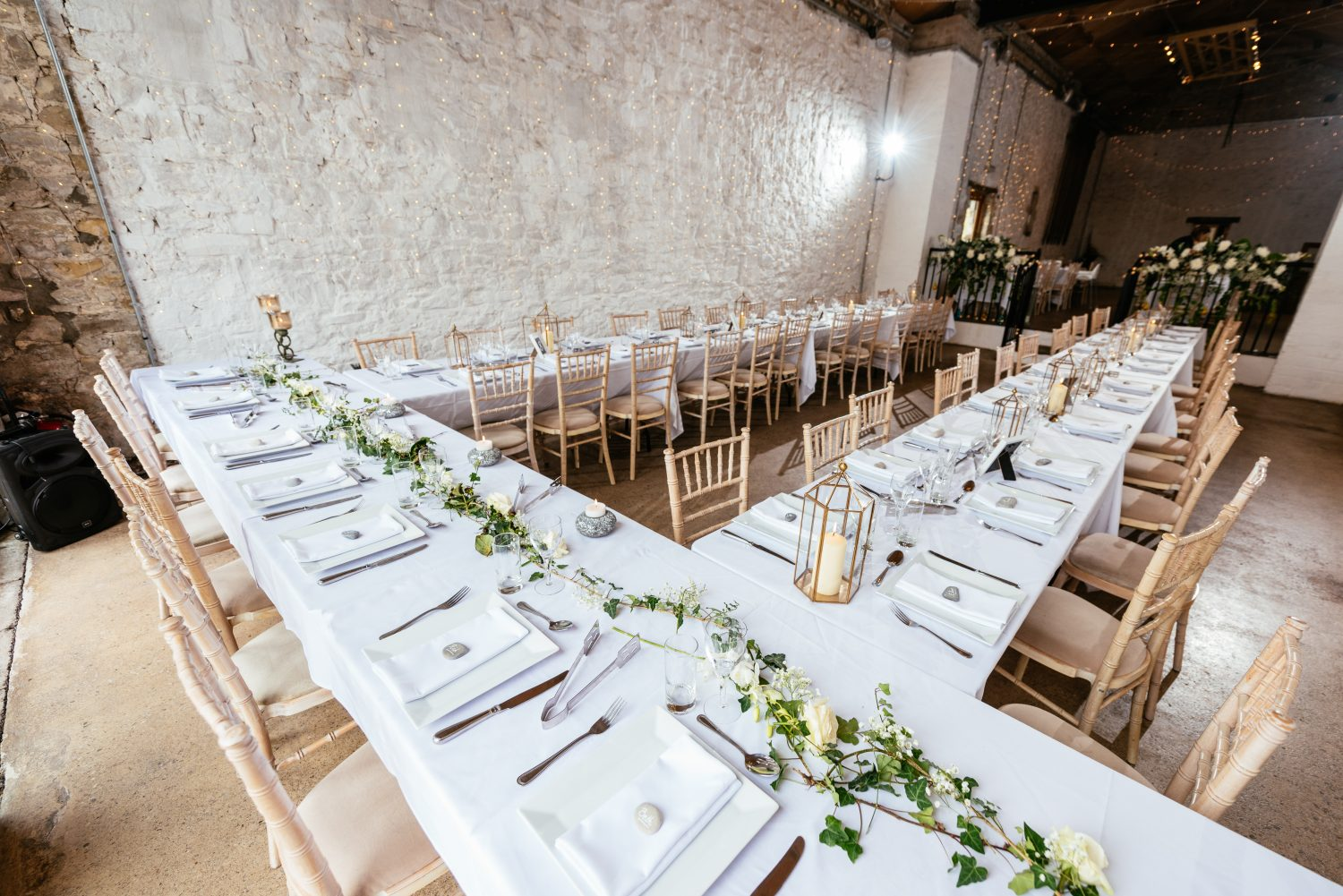 Trestle Table Set up in the Farmer's Barn by South Wales Wedding Photographers